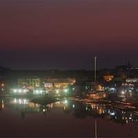 Sacred Puskhar lake (Sagar) and ghats of town Pushkar in twilig