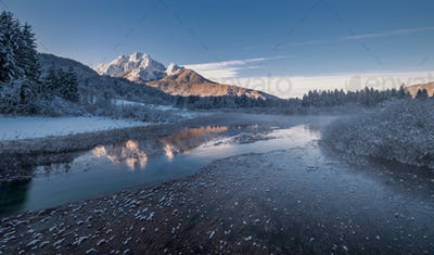 Mountain reflection in the lake in winter time