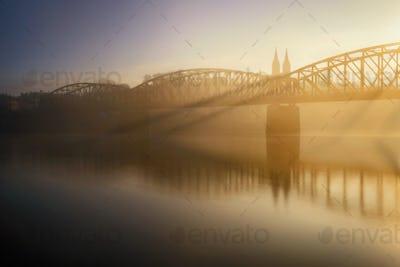 Foggy railway bridge at Prague