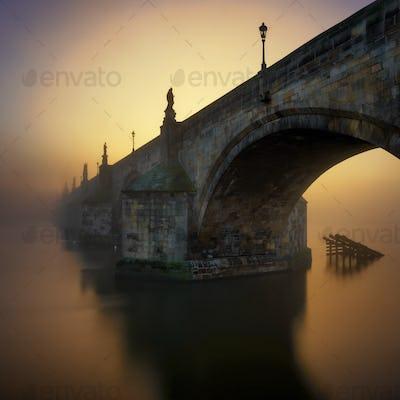 Charles bridge at foggy morning
