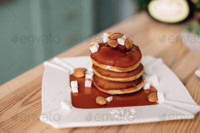 Delicious homemade pancakes with chocolate syrup. Concept of dessers and sweets