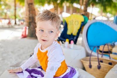 Three year old toddler boy on beach