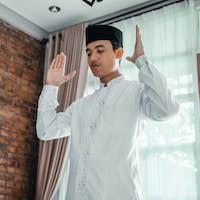 muslim asian man praying to god