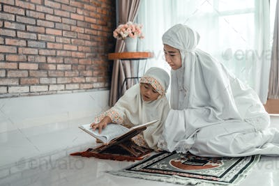 mother and kid reading quran