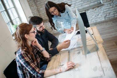 Young architects working on project in office
