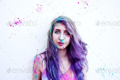 Young woman with paint in her skin