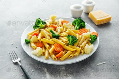 Healthy pasta penne with vegetables on plate