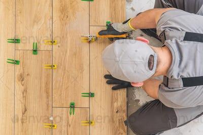 Men Installing Ceramic Floor
