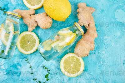 Detox water in bottles with ingredients, ginger, lemon, mint