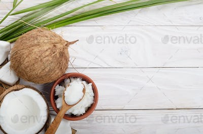 Flat lay Background of coconut, coconut shell, oil in clay bowl