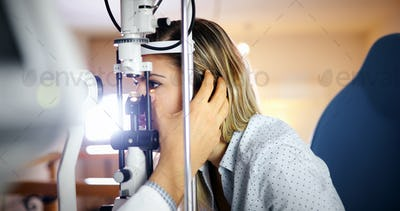 Optometrist examining patient in modern ophthalmology clinic
