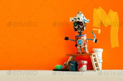 Funny decorator robot repaints the wall of the room orange color.