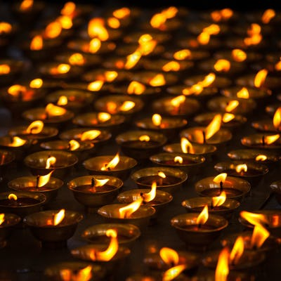 Burning candles in Buddhist temple. McLeod Ganj, Himachal Prades