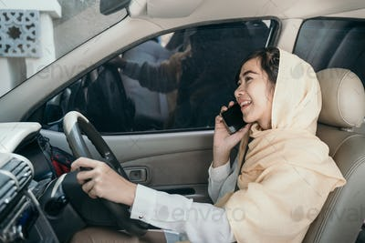 woman driving car while having phone call