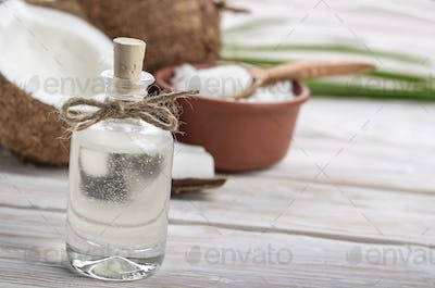 Background of glass jar, coconut, coconut shell, oil in clay bow