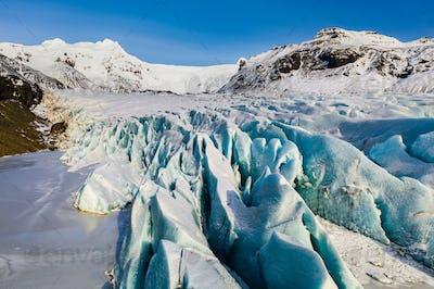 Svinafellsjokull glacier in Iceland at sunset. Aerial view