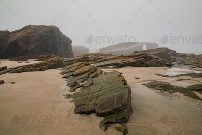 Foggy day on athedrals beach in low tide, Spain