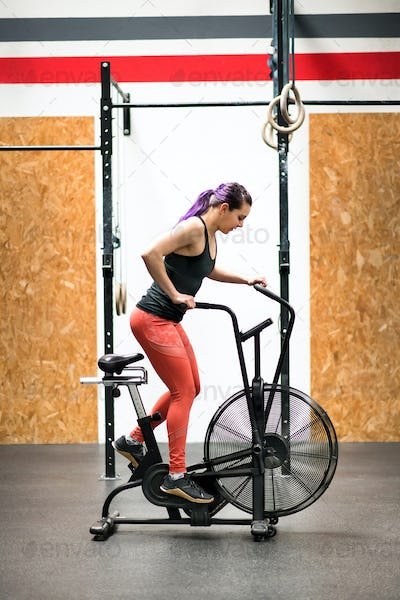 Woman athlete working out on an exercise bike