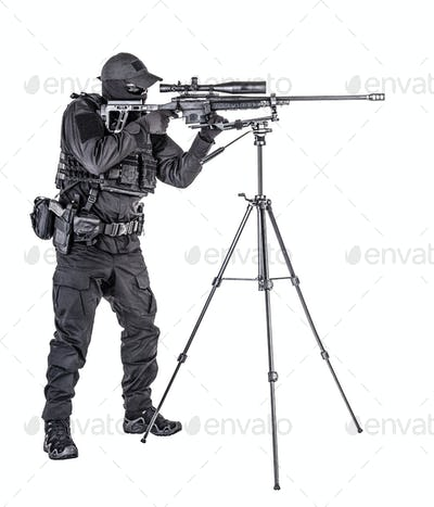 Police SWAT sniper aiming with rifle studio shoot