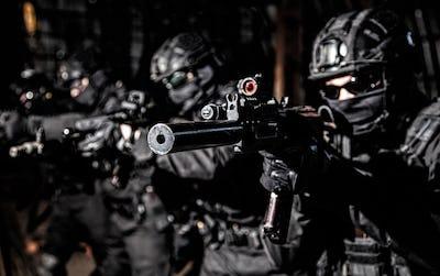 Police SWAT team suppresses criminals with gunfire