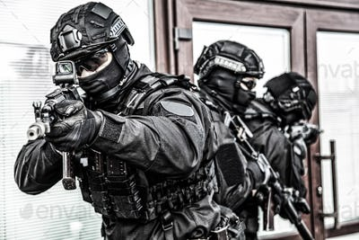 Police special operations forces fighters on raid