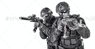 Police elite squad fighters protecting each other