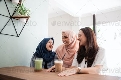 asian muslim woman bestfriend together in cafe