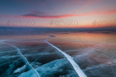Sunset in an ice cave on Lake Baikal in winter