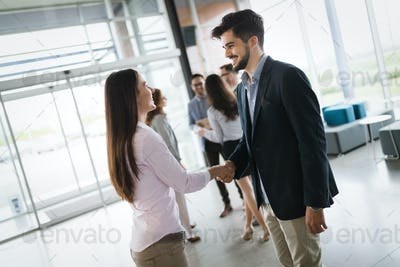 Business shaking hand with a client in modern office