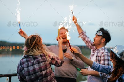 Group of happy friends celebrating at rooftop