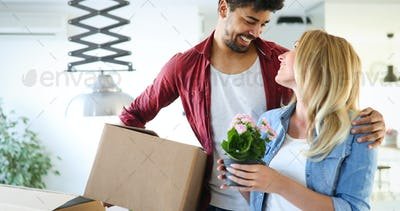 Young couple Moving in new home and unpacking carboard boxes