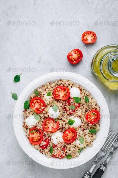 Healthy Bowl Salad with Quinoa, Mozzarella Cheese, Tomatoes and Basil