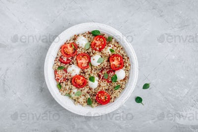 Healthy Bowl Salad with Quinoa, Mozzarella Cheese, Tomatoes and Basil