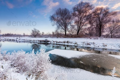 Dawn over the river in winter morning