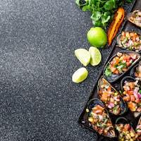 Peruvian Choros a La Chalaca. Mussels with Tomato, Onion and Cilantro Sauce. Copy Space