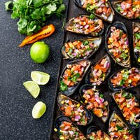 Peruvian Choros a La Chalaca. Mussels with Tomato, Onion and Cilantro Sauce. Top View