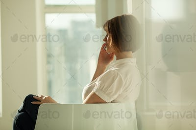 Side view of businesswoman talking on phone