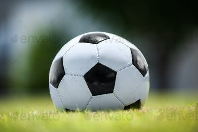 Soccer ball on green lawn