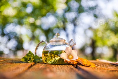 Tea pot of herbal tea on a wooden table