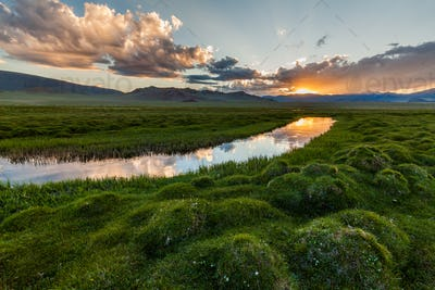 Beautiful sunset over the mountain river in summer