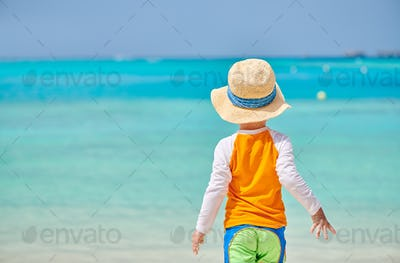Three year old toddler boy on beach