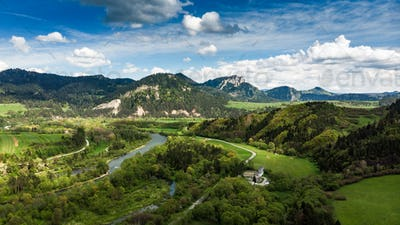 Dunajec river flowing towards Three Crowns mountain peak in Pola