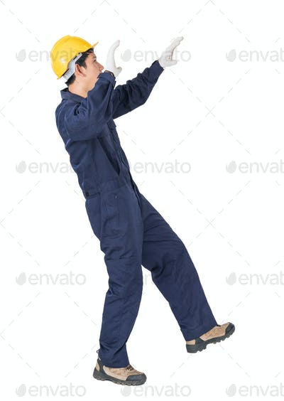Workman with blue coveralls and hardhat in a uniform with clipping path 3