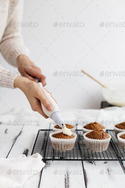 Woman Baking Carrot Cupcakes