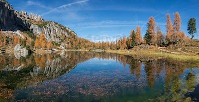 Autumn fairytale in the Dolomites mountains landscape