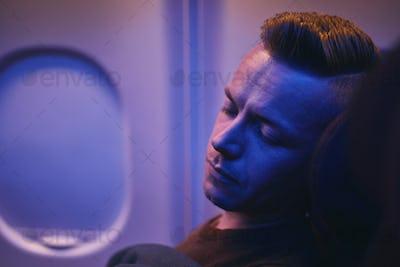 Man sleeping during flight