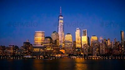 New York City Skyline with Skyscrapers Illuminated at Dusk