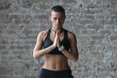 athletic female doing exercise in yoga class