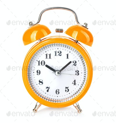 Retro alarm clock close-up isolated on a white background.