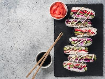 Vegan onigirazu, top view, copy space